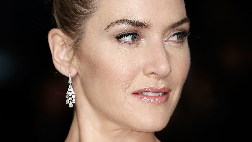 Kate Winslet glaring out of the corner of her eyes