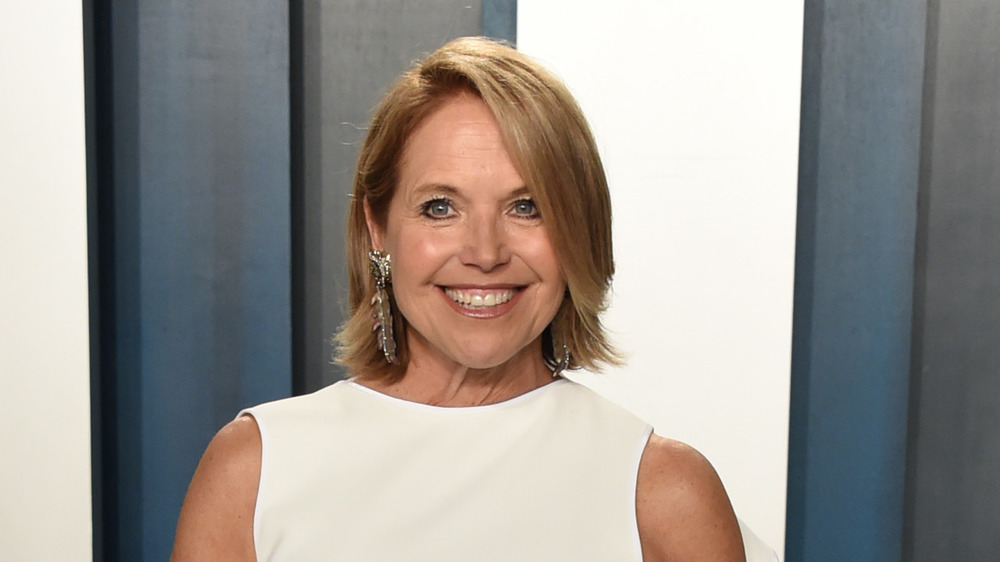 Katie Couric wearing a white tunic
