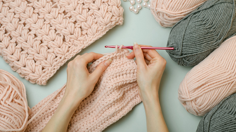Female hand crochets