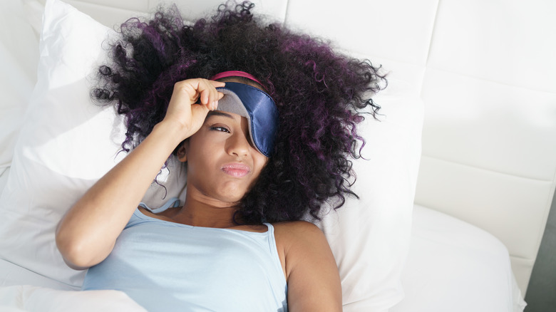 Woman struggling to wake up