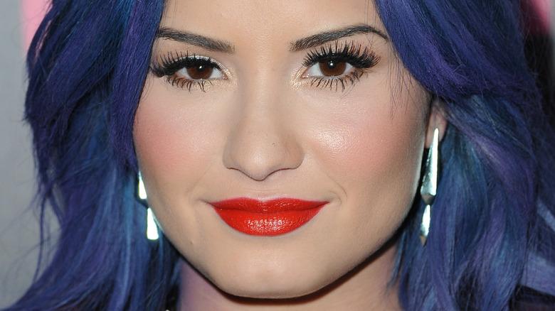 Demi Lovato with dark blue hair