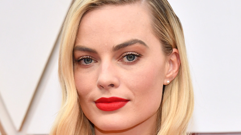 Margot Robbie poses on the red carpet