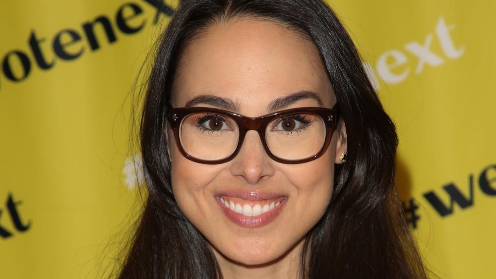 Meena Harris smiling in glasses
