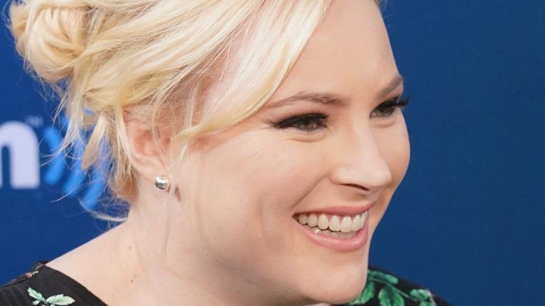Meghan McCain smiling into mic