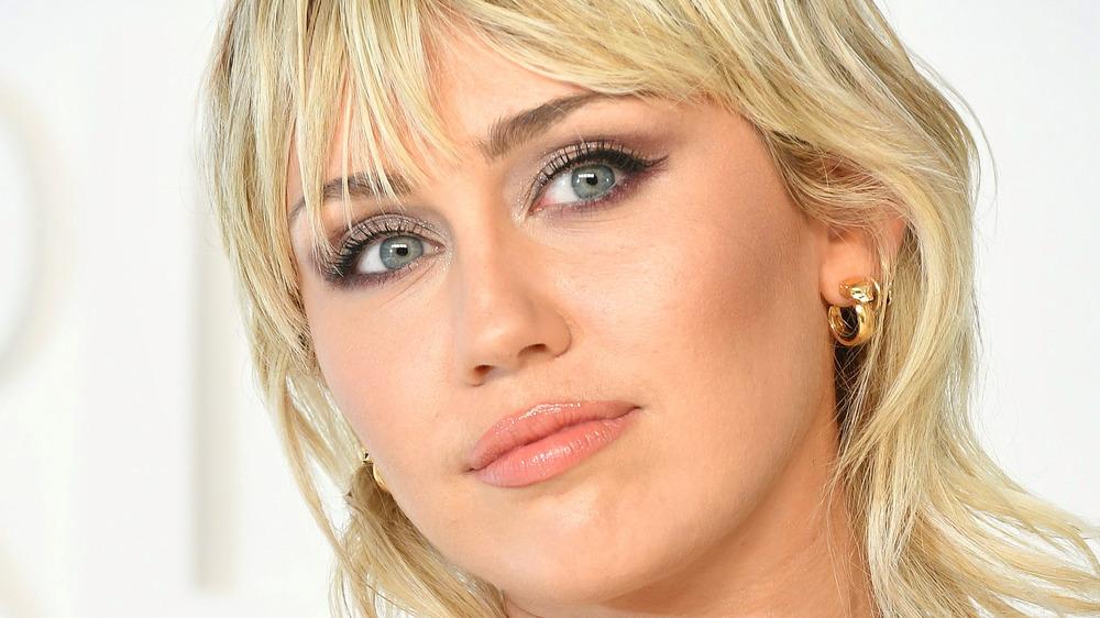 Miley Cyrus head tilted