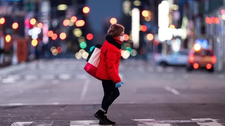 Woman walking across the street in New York