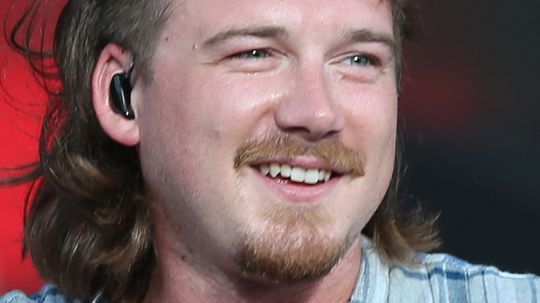 Morgan Wallen smiling on stage