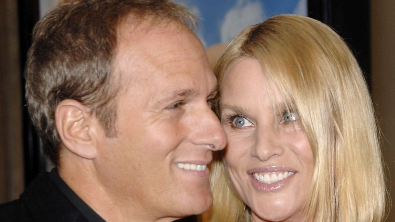 Nicollette Sheridan and Michael Bolton cuddle on red carpet
