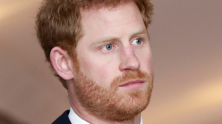 Prince Harry staring sternly to the side
