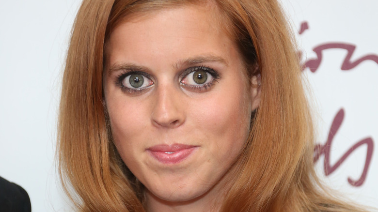 Princess Beatrice smiling at an event.