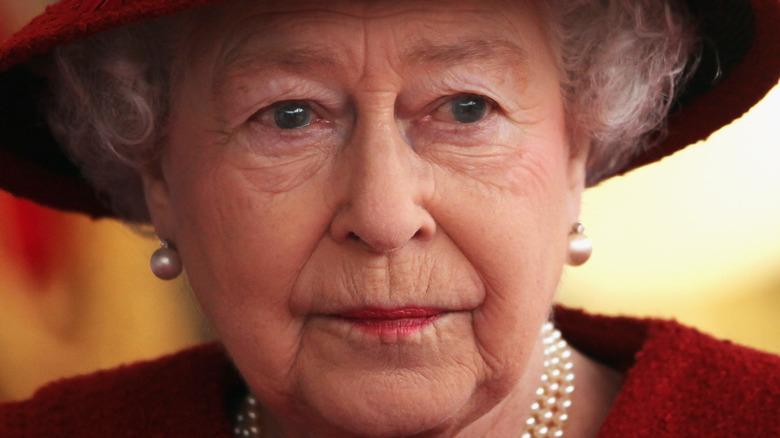 Queen Elizabeth looking stoic in red