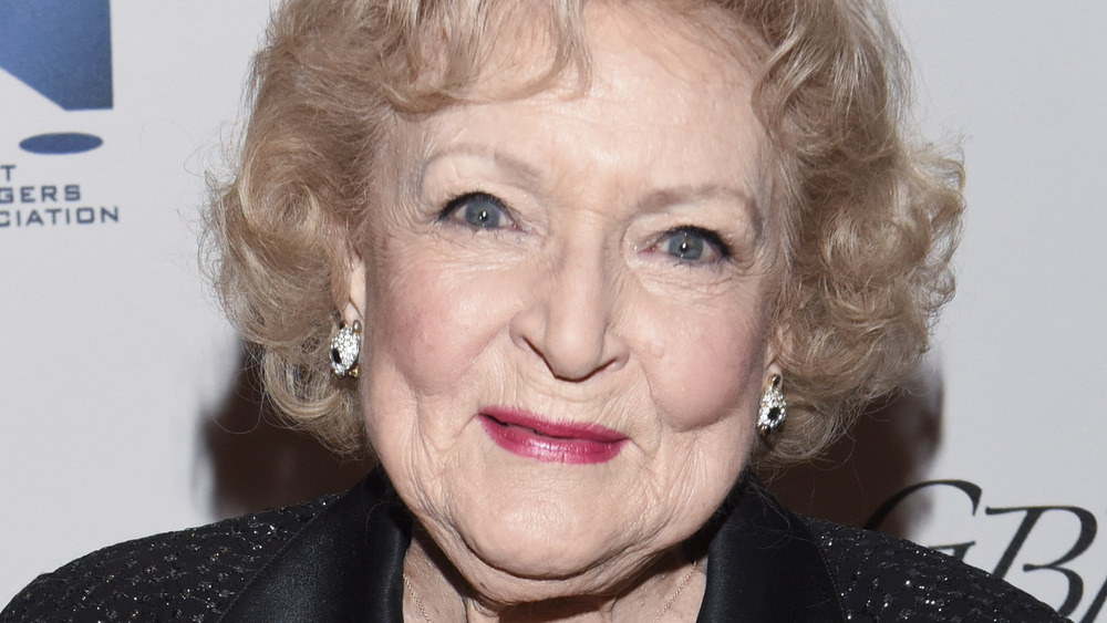 Betty White smiling on red carpet