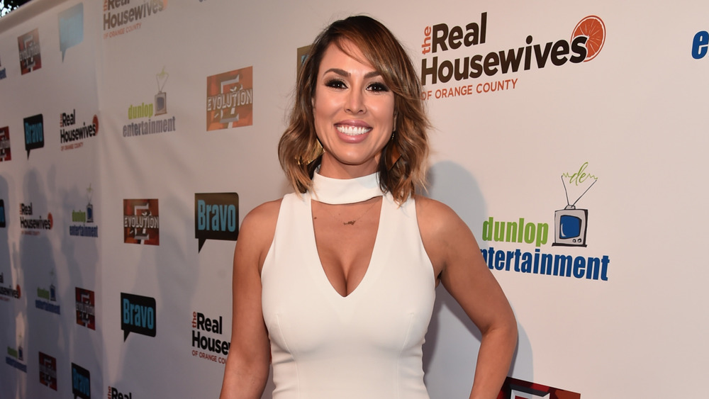 Kelly Dodd wears white at event