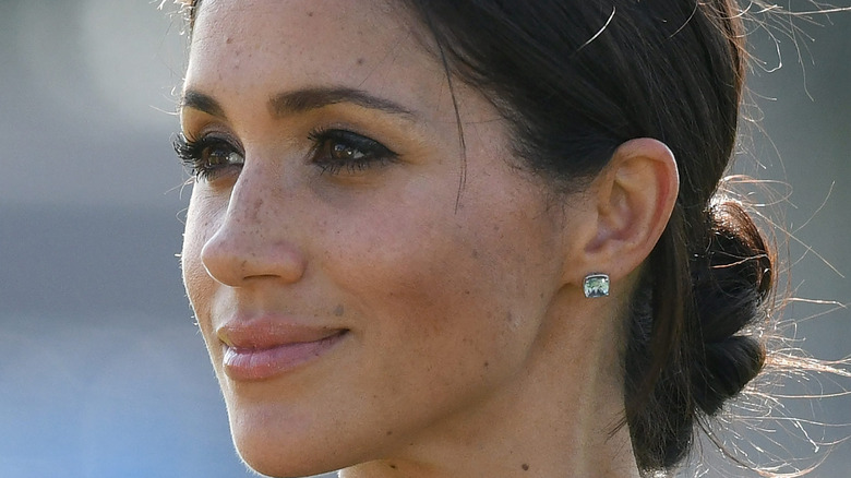 Meghan Markle smiles at an event.