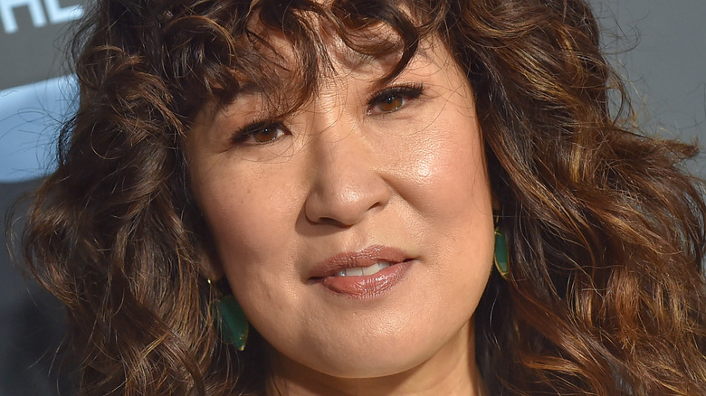 Sandra Oh smiling on the red carpet