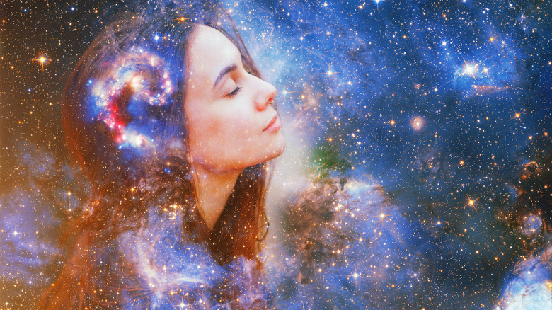 A woman's face amongst the stars and galaxies
