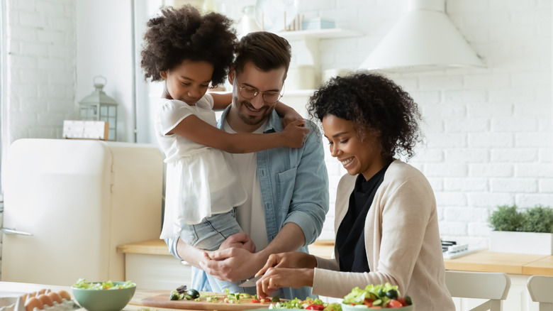 Family cooking together in kitchen