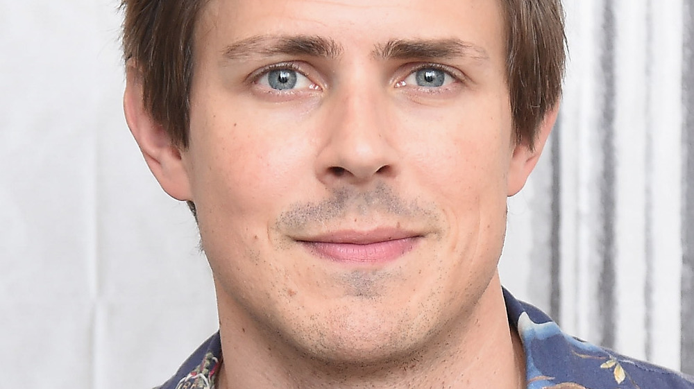 Chris Lowell smiling