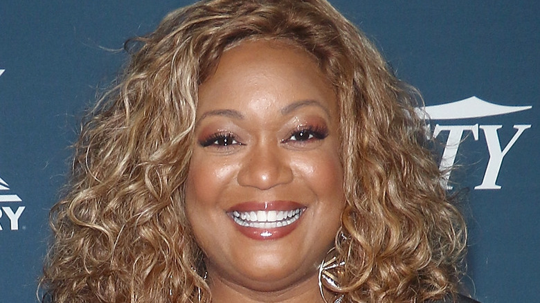 Sunny Anderson smiling on red carpet