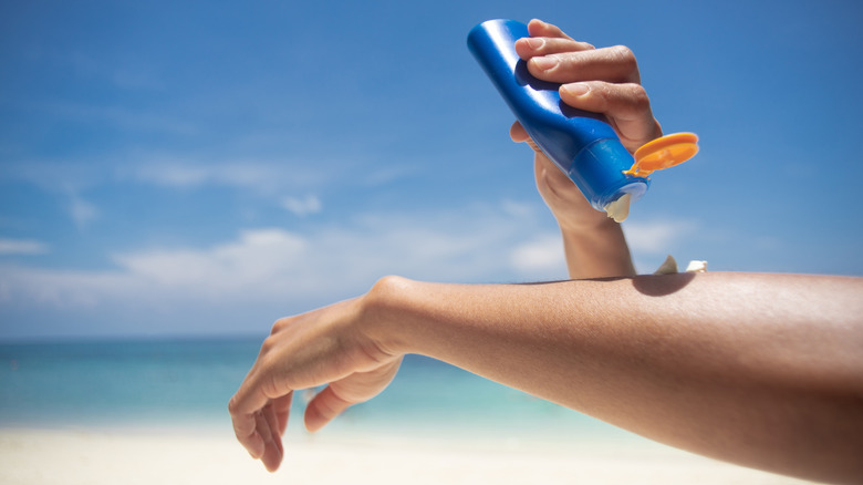 Person applying sunscreen
