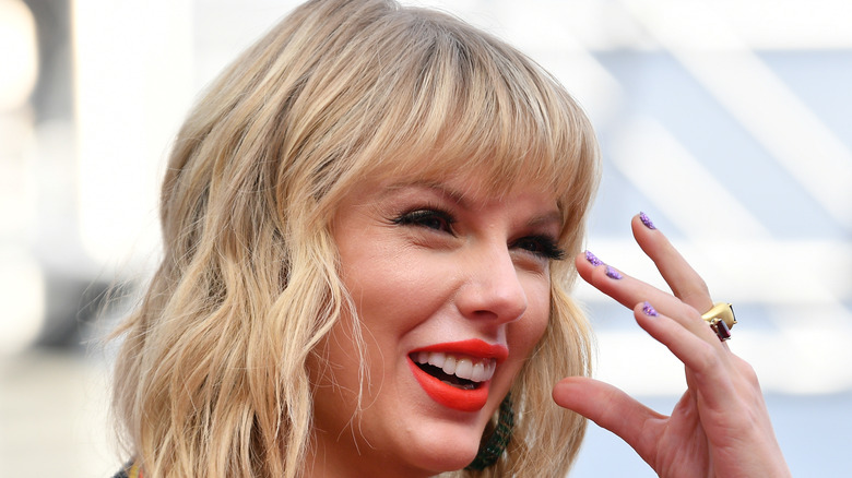 Taylor Swift smiles on the red carpet