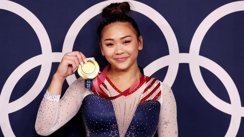 gymnastics star Sunisa Lee with gold medal