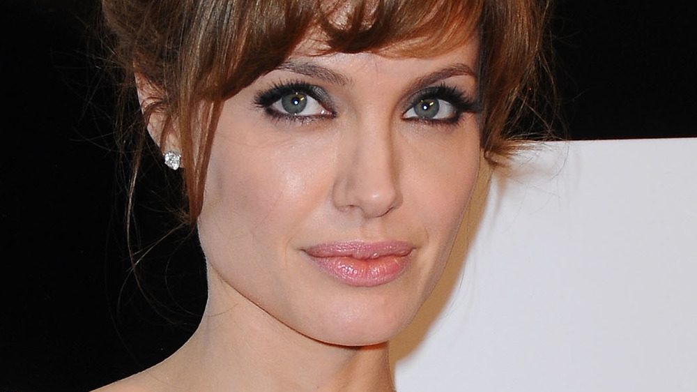 Angelina Jolie posing for cameras
