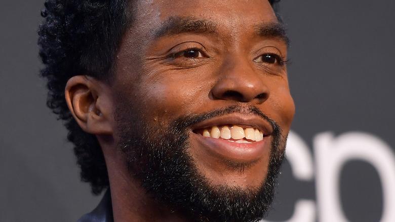 Chadwick Boseman smiling with facial hair