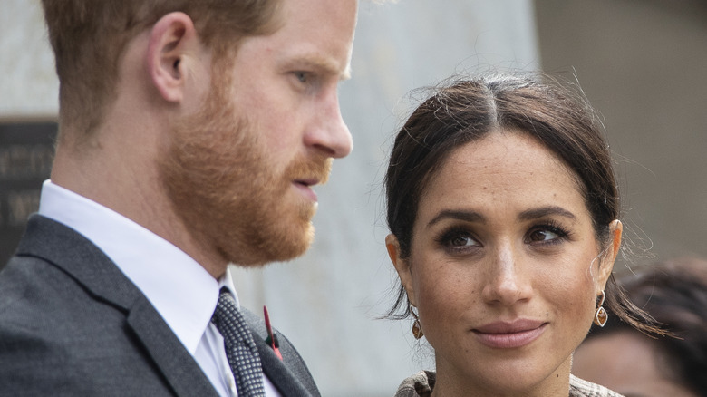 Meghan Markle looks knowingly at Prince Harry