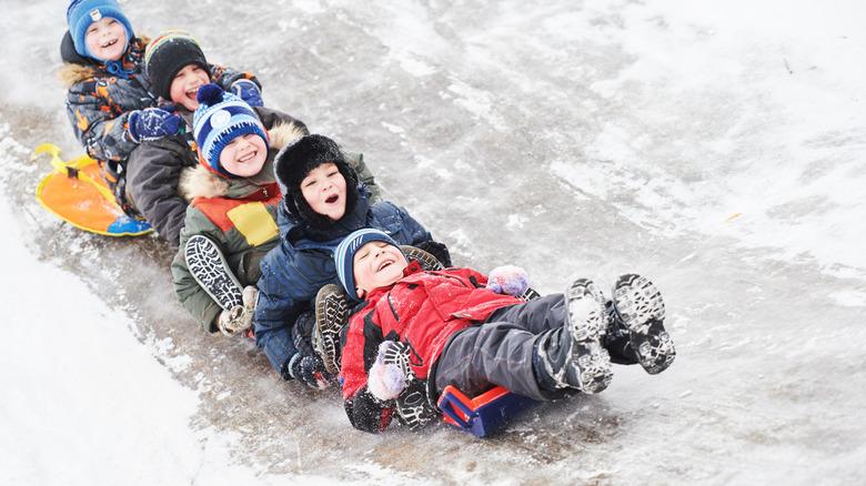 Children sledding in the snow