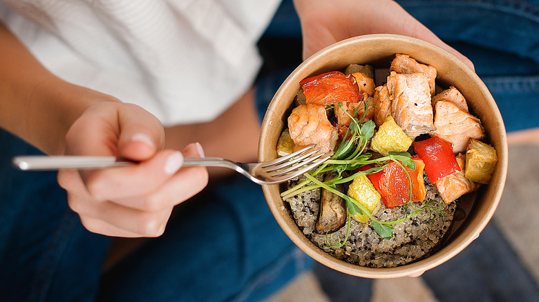 Woman holding sushi bowl