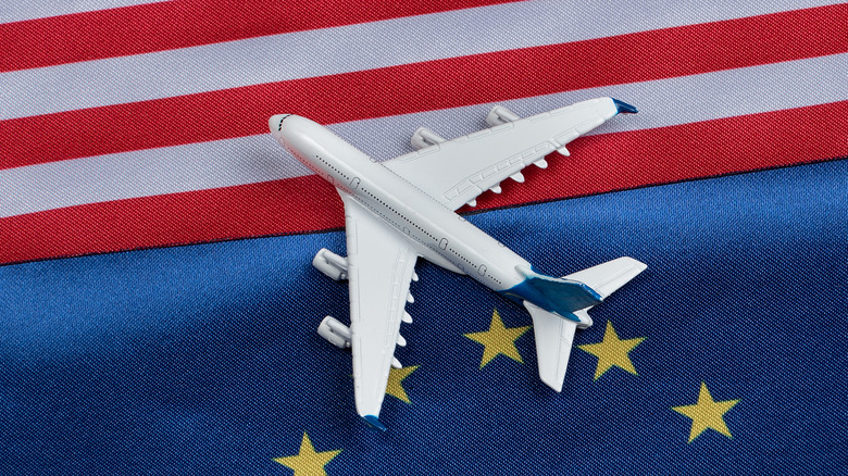 EU/US flags with small plane