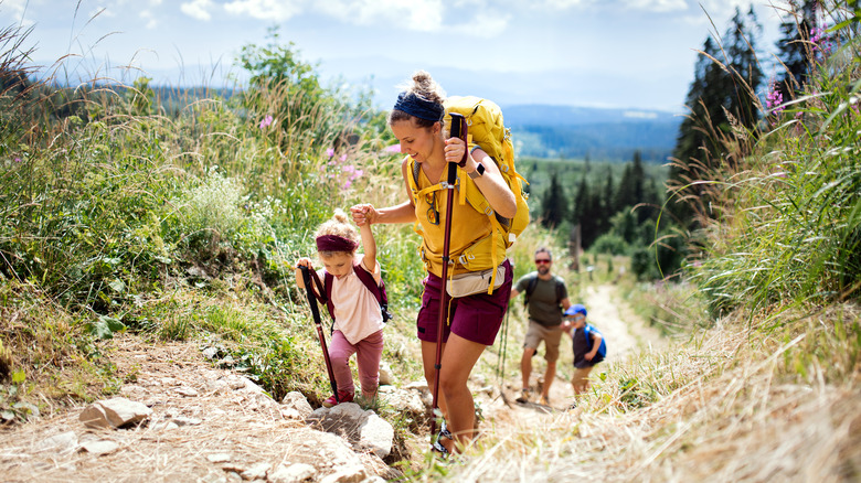 Woman hiking with her children