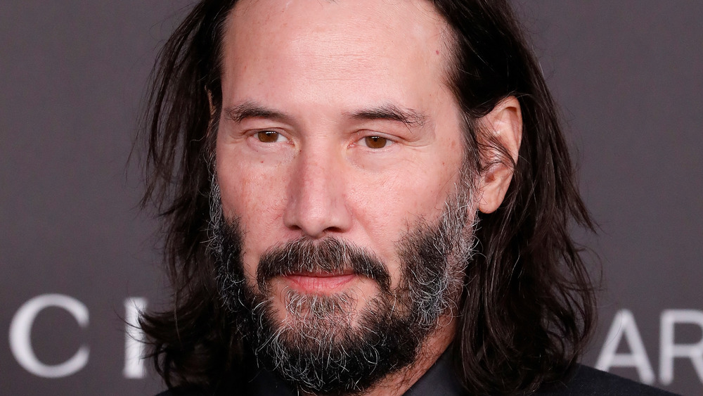 Keanu Reeves posing with a neutral expression