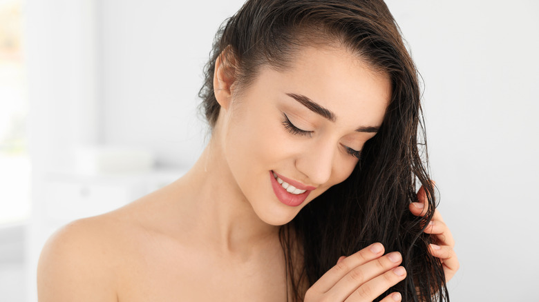 Girl Applying Leave-In Conditioner