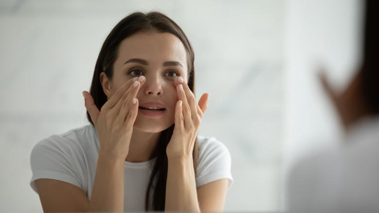 Woman smoothing skin