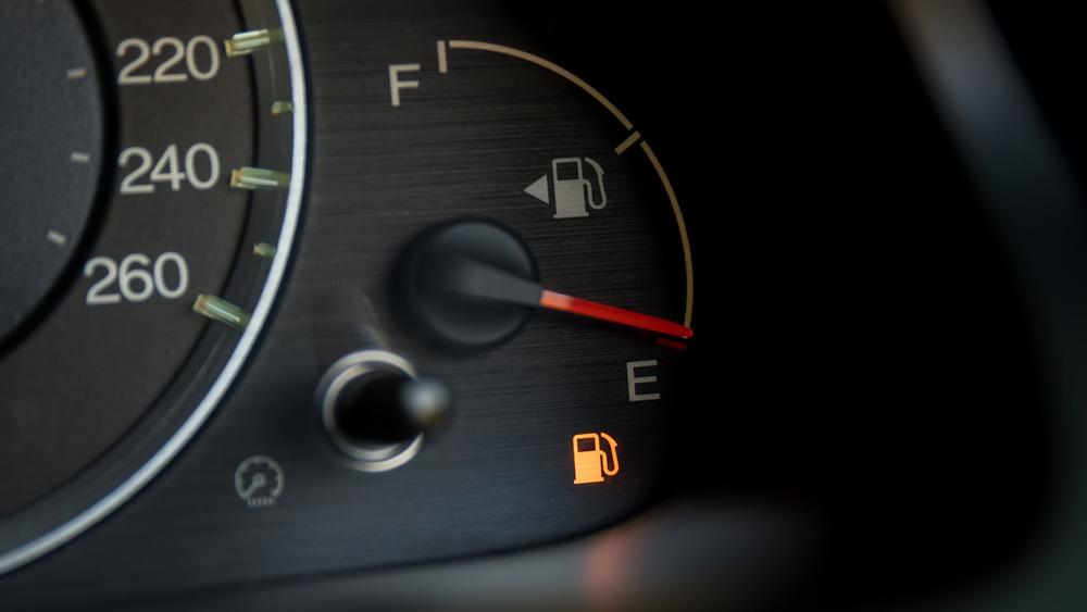 Fuel gauge empty light on