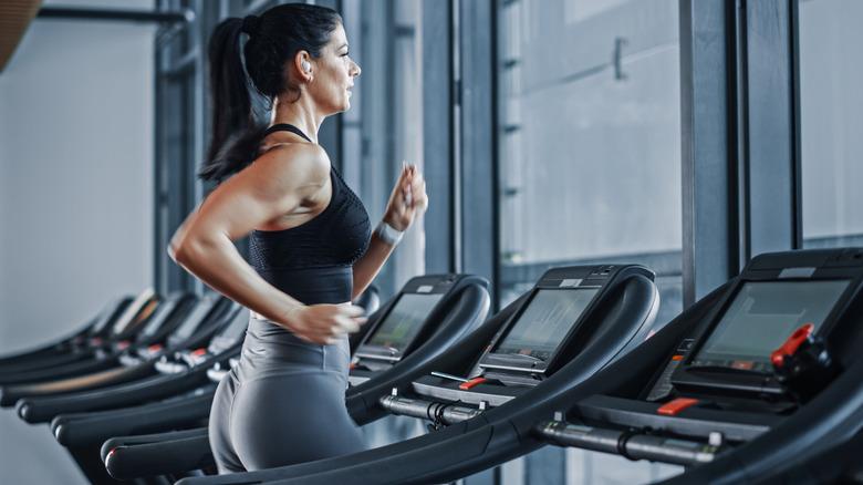 Woman using headphones on the treadmill