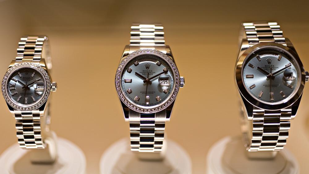 Three Rolex watches on display