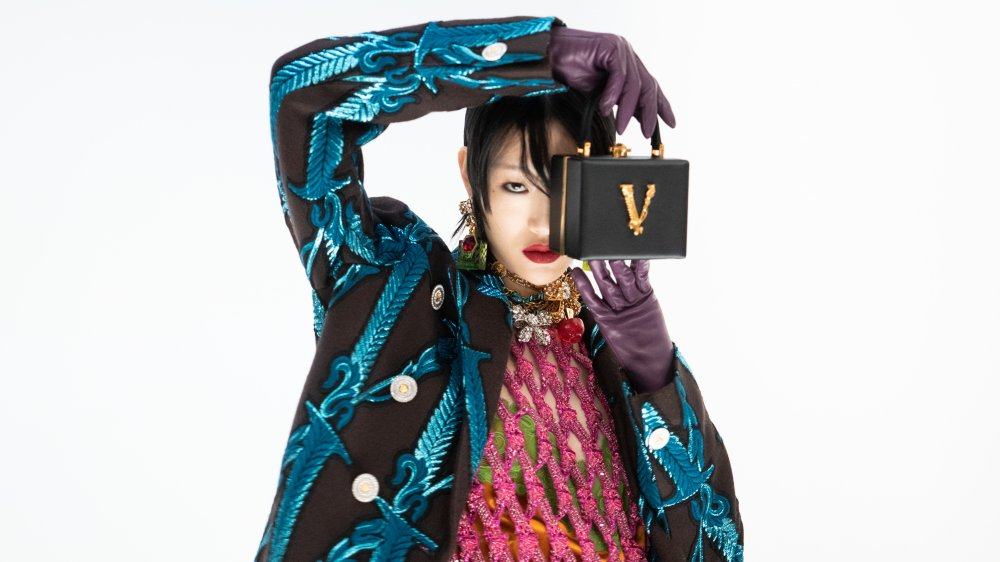 Model holding Versace bag