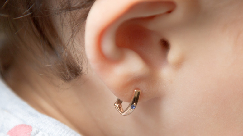 Baby ear with gold hoop earring