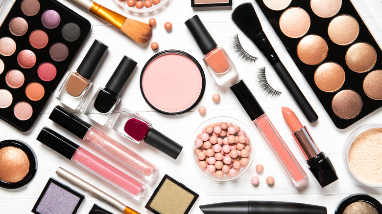 Varied makeup products on a white background