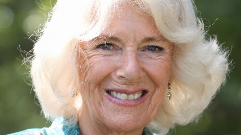 Camilla, Duchess of Cornwall, smiles at an event.