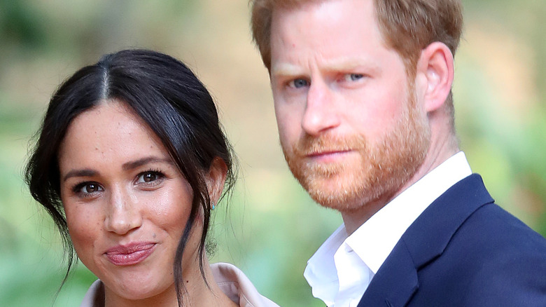 Meghan Markle and Prince Harry staring at paparazzi