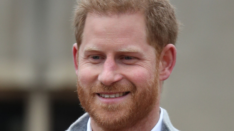 Prince Harry smiles for the camera.