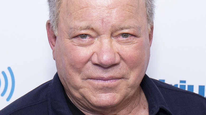 William Shatner poses on the red carpet