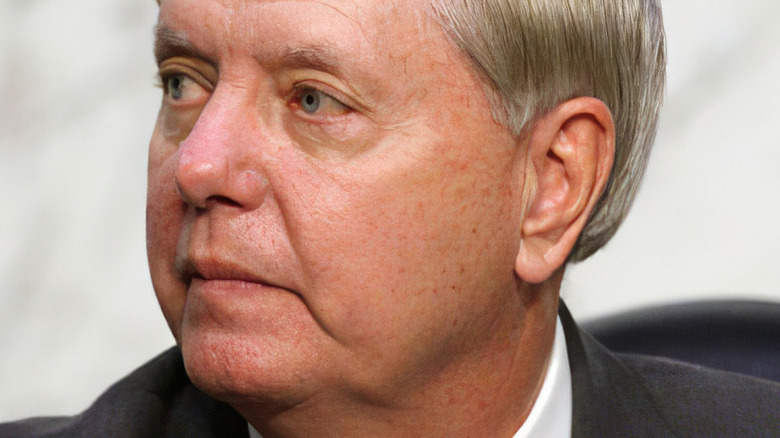 Senator Lindsey Graham looking to the side with serious expression