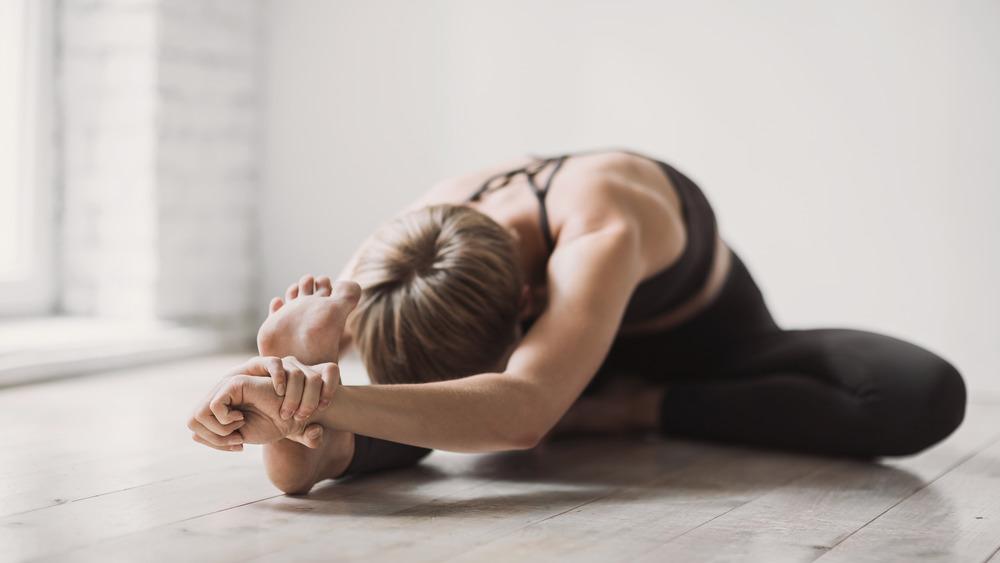 Woman stretching her leg