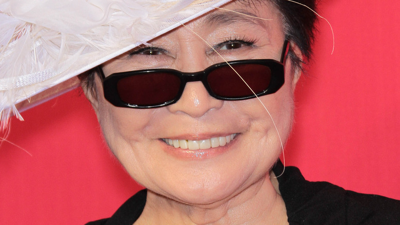 Yoko Ono in feathered hat
