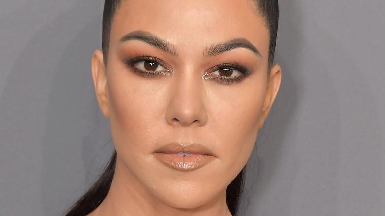 Kourtney Kardashian wears high ponytail